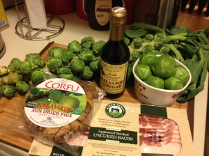 Brussels sprouts on the stalk, dried figs, bacon, balsamic vinegar, and brussels sprouts off the stalk.