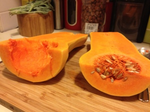 Halved squash; one intact, one gutted.